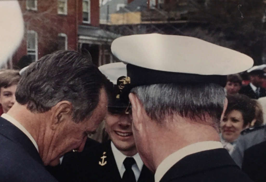 Mike Garcia in dress uniform shaking hands with President George Bush.