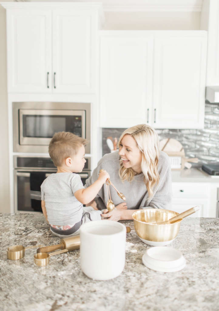 Mike's wife Rebecca baking in the kitchen with son Jett (age 2).