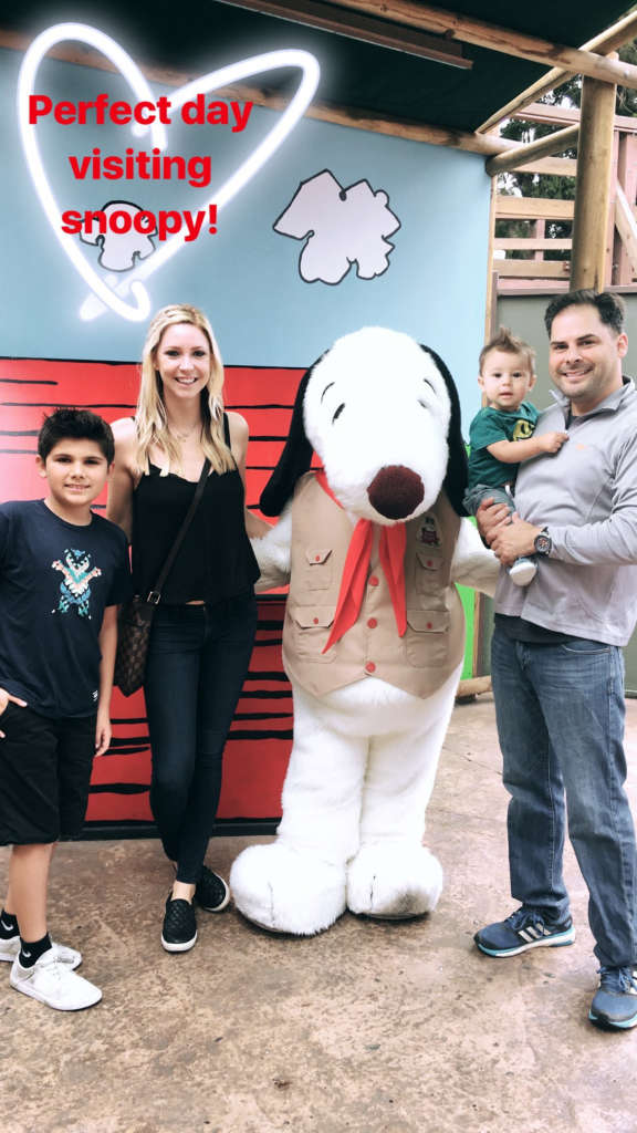 Mike Garcia with family posing with Snoopy at Knotts Betty Farm.